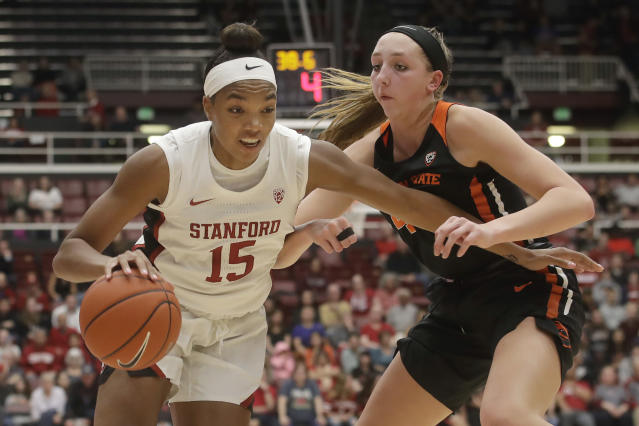 Stanford forward Maya Dodson (15) drives against Oregon State forward Taylor Jones during the second half of an NCAA college basketball game in Stanford, Calif., Friday, Feb. 21, 2020. (AP Photo/Jeff Chiu)