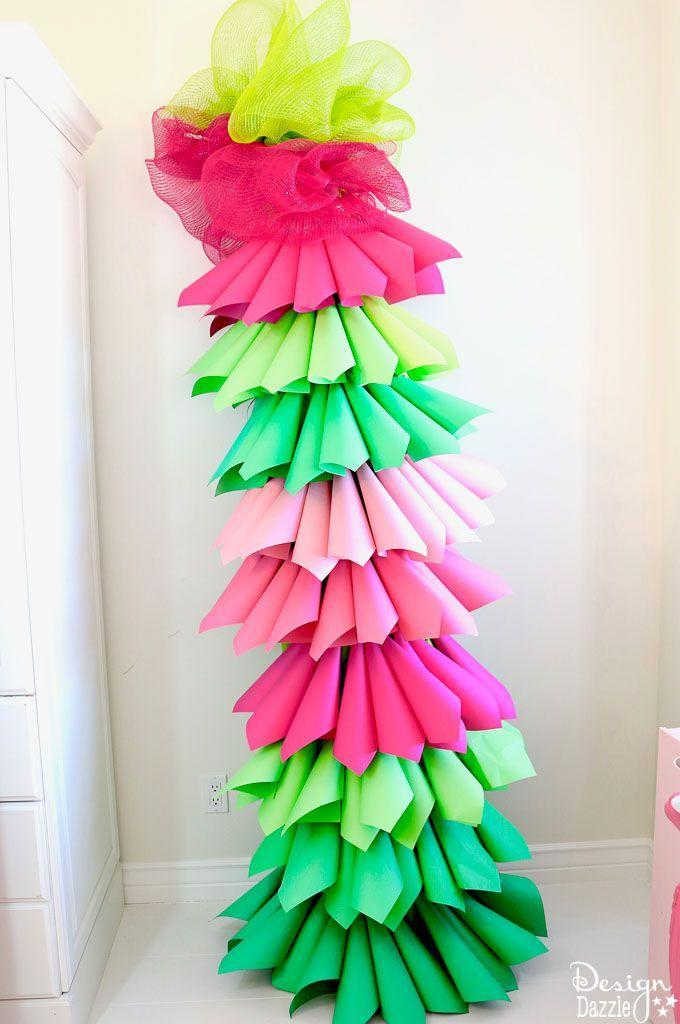 "<p>Whether you're hosting a Grinch-themed breakfast or need to brighten up an empty corner with some color, this fun DIY tree is straight out of Whoville!</p><p><strong>Get the tutorial at</strong> <a href=""https://www.designdazzle.com/grinch-inspired-paper-cone-tree/"" rel=""nofollow noopener"" target=""_blank"" data-ylk=""slk:Design Dazzle."" class=""link rapid-noclick-resp"">Design Dazzle.</a></p><p><a class=""link rapid-noclick-resp"" href=""https://www.amazon.com/Recollections-Cardstock-Paper-Feathered-Greens/dp/B00TEF9QDE/ref=sr_1_9?dchild=1&keywords=green+cardstock&qid=1603062640&sr=8-9&tag=syn-yahoo-20&ascsubtag=%5Bartid%7C10050.g.28982778%5Bsrc%7Cyahoo-us"" rel=""nofollow noopener"" target=""_blank"" data-ylk=""slk:SHOP CARDSTOCK"">SHOP CARDSTOCK</a></p>"