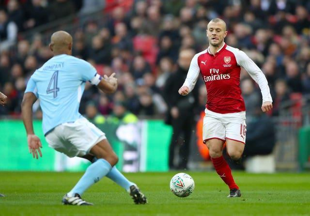 Jack Wilshere (right) in action for Arsenal