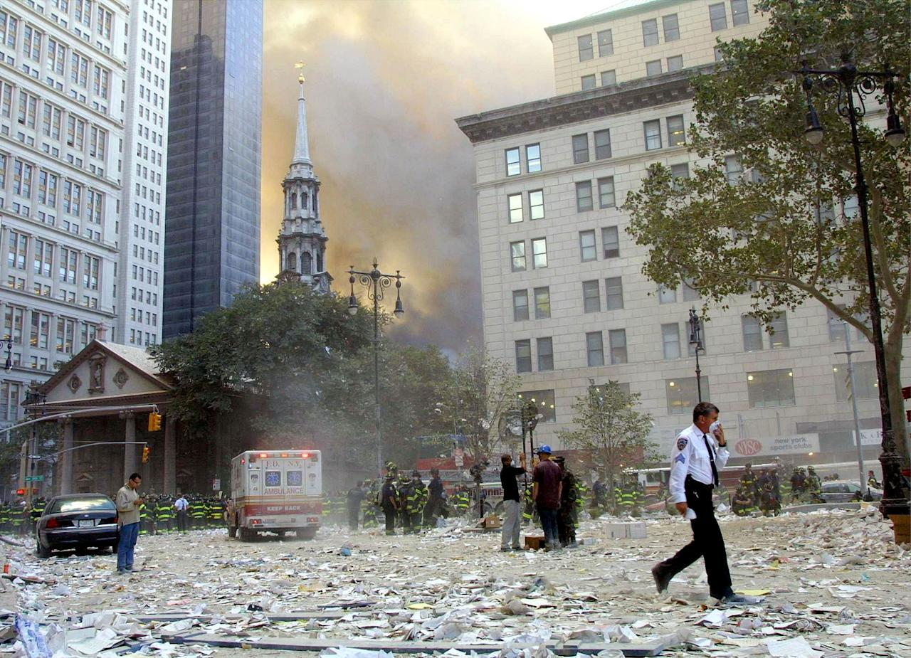 NEW YORK, NY - FILE:  People walk away from the area where the World Trade Center buildings collapsed after two airplanes slammed into the twin towers in a suspected terrorist attack September 11, 2001 in New York City.  U.S. President Barack Obama announced the death of Osama Bin Laden during a late evening statement to the press May 1, 2011 in the East Room of the White House. Bin Laden has reportedly been killed near Islamabad, Pakistan, almost a decade after the terrorist attacks of September 11, 2001 and his body is in possession of the United States.  (Photo by Mario Tama/Getty Images)