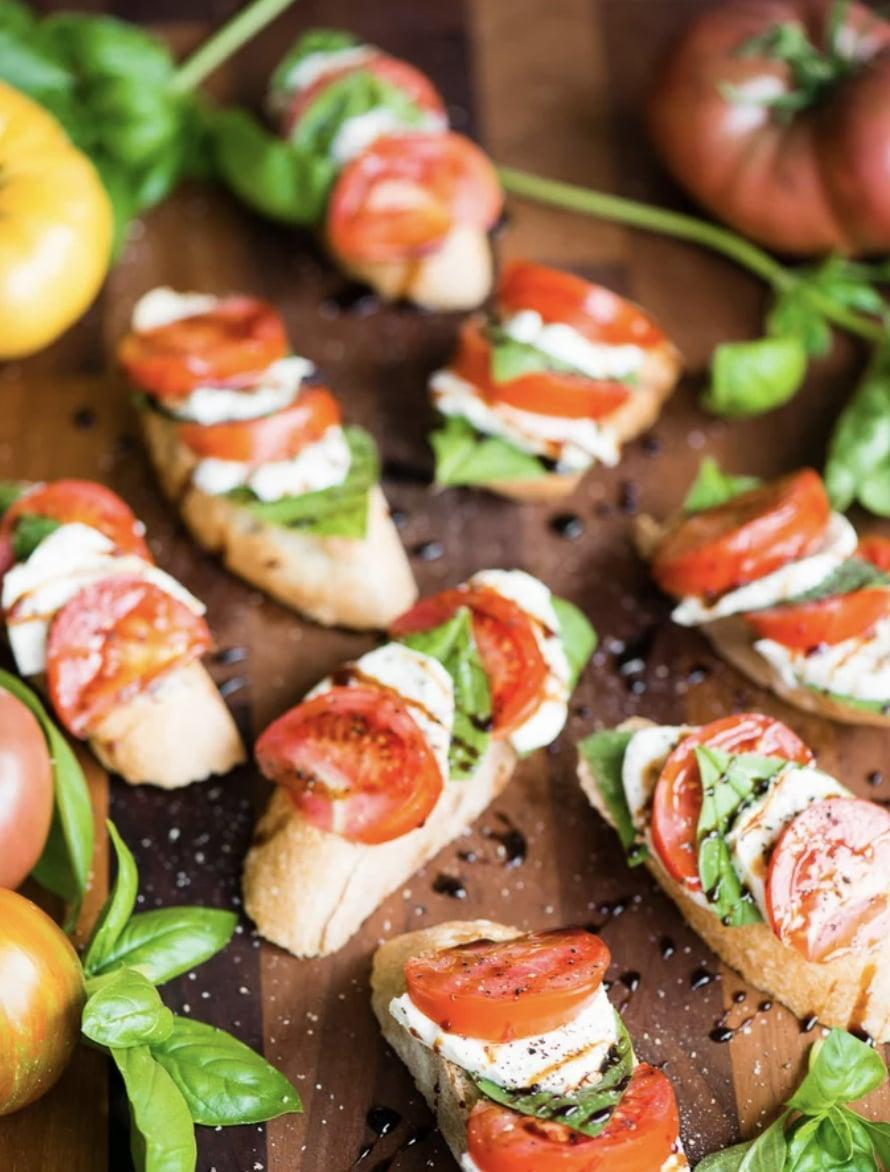 """<p>Stick with the ultimate classic caprese bruschetta to kick off your game day dinner this year. It's light, refreshing, and seriously underrated! To adjust the recipe to the amount of servings you want to make, just toggle the scale in the """"servings"""" section, and you can get cookin'!</p> <p><strong>Get the recipe:</strong> <a href=""""https://selfproclaimedfoodie.com/caprese-bruschetta/"""" class=""""link rapid-noclick-resp"""" rel=""""nofollow noopener"""" target=""""_blank"""" data-ylk=""""slk:caprese bruschetta"""">caprese bruschetta</a></p>"""