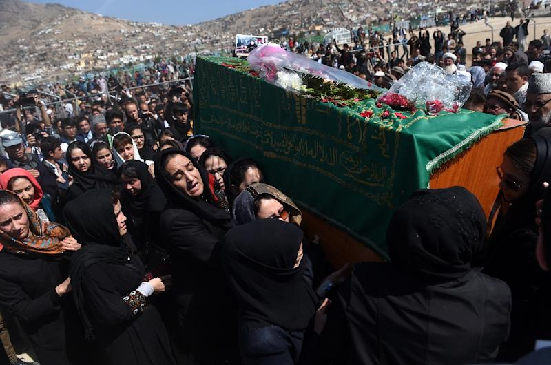 Independent Afghan civil society activist women carry the coffin of Farkhunda, 27, who was lynched by an angry mob in central Kabul on March 22, 2015. Hundreds of people on March 22, attended the burial of an Afghan woman who was beaten to death and set on fire by a mob for allegedly burning a copy of the Koran. The body of Farkhunda, 27, who was lynched on March 19 by an angry mob in central Kabul, was carried to the graveyard by women amid crowds of men, an AFP reporter said, a rare act of protest in a male-dominated society. AFP PHOTO / Wakil Kohsar (AFP Photo/Wakil Kohsar)