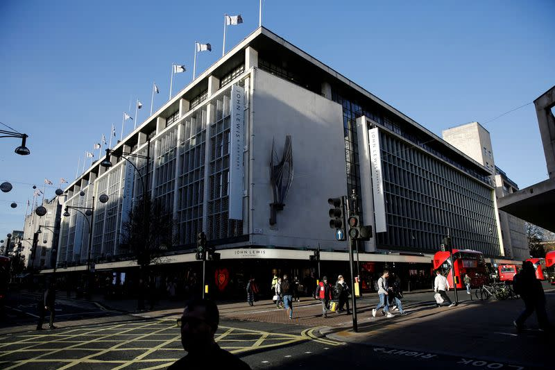 FILE PHOTO: Shoppers walk past the John Lewis department store on Oxford Street in London