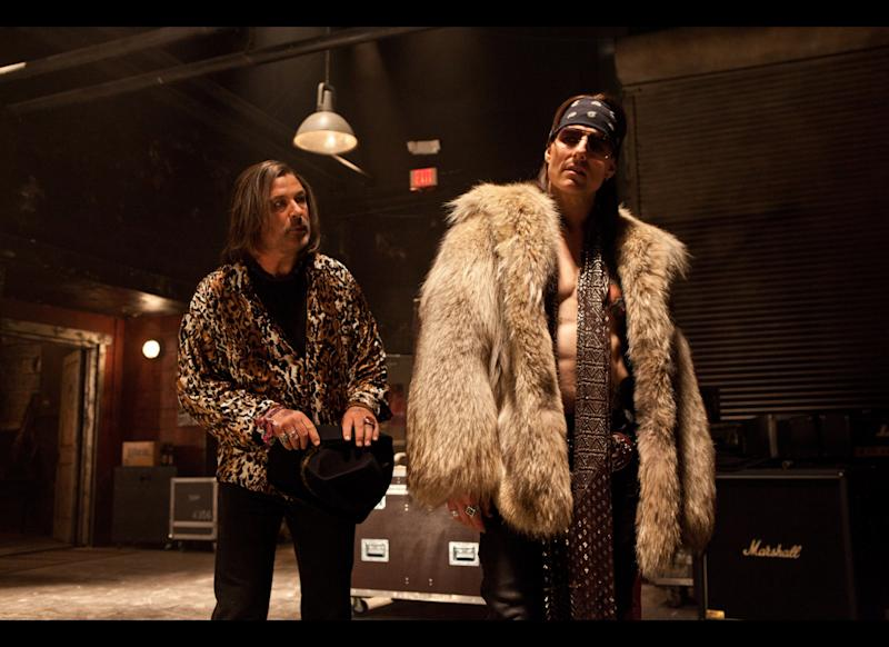 "Alec Baldwin as Dennis Dupree, left, and Tom Cruise as Stacee Jaxx in the film ""Rock of Ages."""