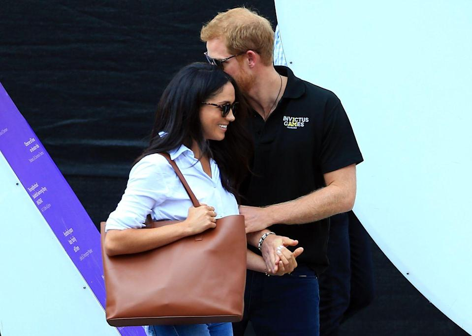 <p>Hand-in-hand on the same day, Harry appeared to be whispering sweet nothings to his wife-to-be on the sidelines of the Invictus Games.</p>