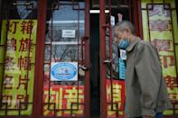 Chinese authorities are using a mix of perks and pressure to hasten the uptake of Covid-19 jabs