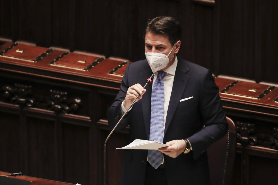 Premier Giuseppe Conte delivers his speech at the lower chamber of Parliament, in Rome, Monday, Jan. 18, 2021. Conte fights for his political life with an address aimed at shoring up support for his government, which has come under fire from former Premier Matteo Renzi's tiny but key Italia Viva (Italy Alive) party over plans to relaunch the pandemic-ravaged economy. (AP Photo/Alessandra Tarantino, pool)