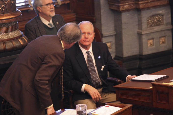 Kansas Senate Majority Leader Gene Suellentrop, right, R-Wichita, confers with Sen. Mike Thompson, R-Shawnee, during the Senate session Wednesday, March 17, 2021, at the Statehouse in Topeka, Kan. Suellentrop is stepping aside from most of the majority leader's duties following his arrest on suspicion of driving under the influence and attempting to flee law enforcement. (AP Photo/John Hanna)