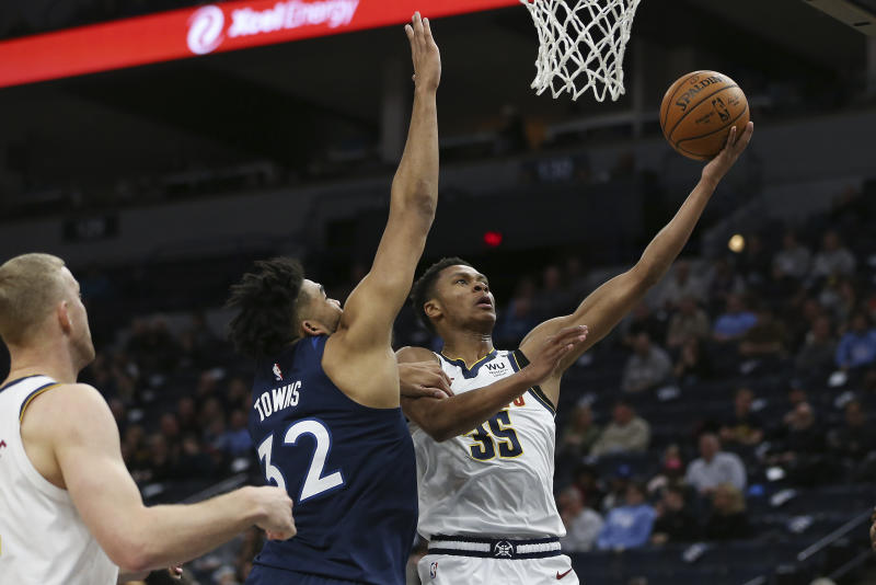 Denver Nuggets' PJ Dozier goes up to the basket against Minnesota Timberwolves' Karl-Anthony Towns in the second half of an NBA basketball game Monday, Jan. 20, 2020, in Minneapolis. Denver won 107-100. (AP Photo/Stacy Bengs)