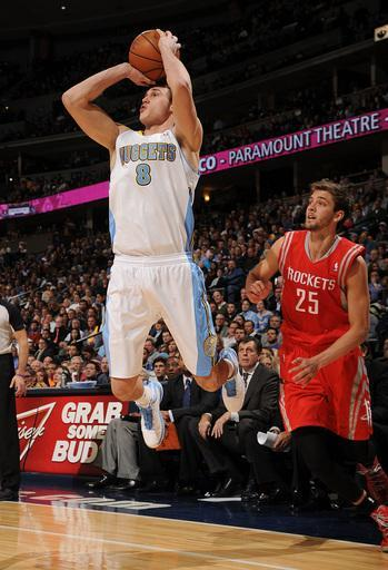 DENVER, CO - JANUARY 30: Danilo Gallinari #8 of the Denver Nuggets shoots against Chandler Parsons #25 of the Houston Rockets on January 30, 2013 at the Pepsi Center in Denver, Colorado. (Photo by Garrett W. Ellwood/NBAE via Getty Images)