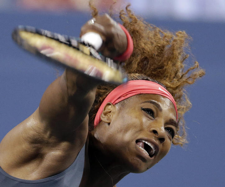 Serena Williams serves to Yaroslava Shvedova, of Kazakhstan, during a third round match at the U.S. Open tennis tournament, early Saturday, Aug. 31, 2013, in New York. (AP Photo/Darron Cummings)