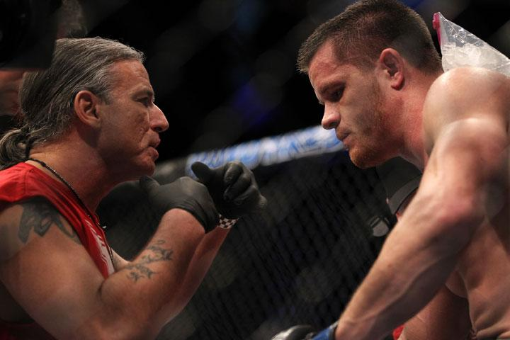 LAS VEGAS, NV - MAY 26:  CB Dollaway (right) receives instructions from his teammate during a middleweight bout at UFC 146 at MGM Grand Garden Arena on May 26, 2012 in Las Vegas, Nevada.