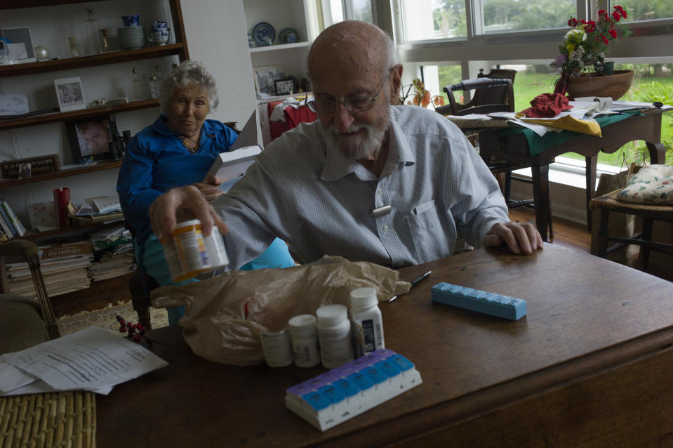 Charles Miller, 90, prepares the daily pills his wife will need for the week on January 4, 2020 in Sarasota, Florida. (Photo: Andrew Lichtenstein/Corbis via Getty Images)