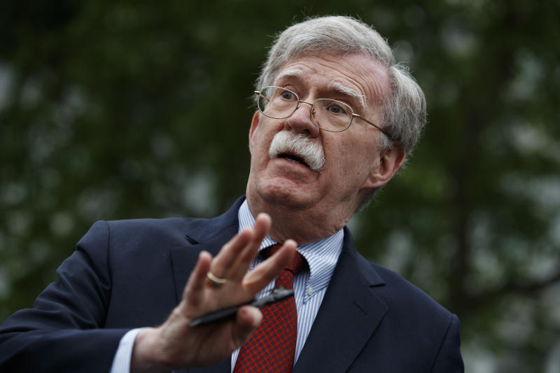 John Bolton talks to reporters in May. (Photo: Evan Vucci/AP)