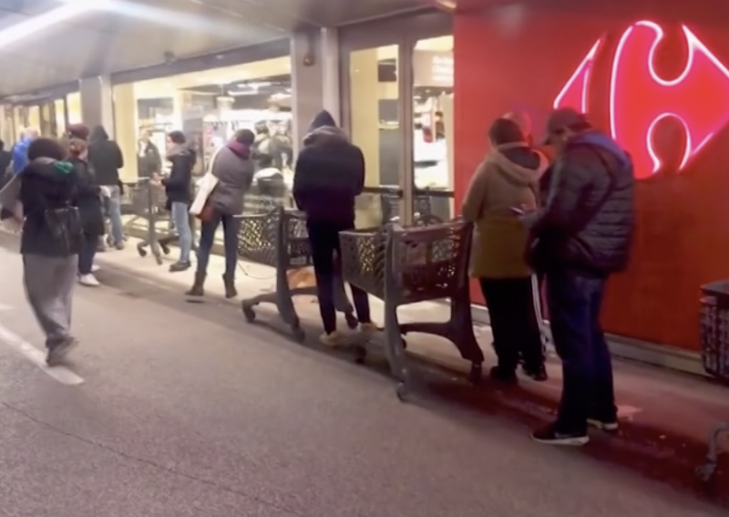 Shoppers with their trolleys outside a supermarket in Italy. Independent business owners are worried what the coronavirus lockdown will do to the economy.