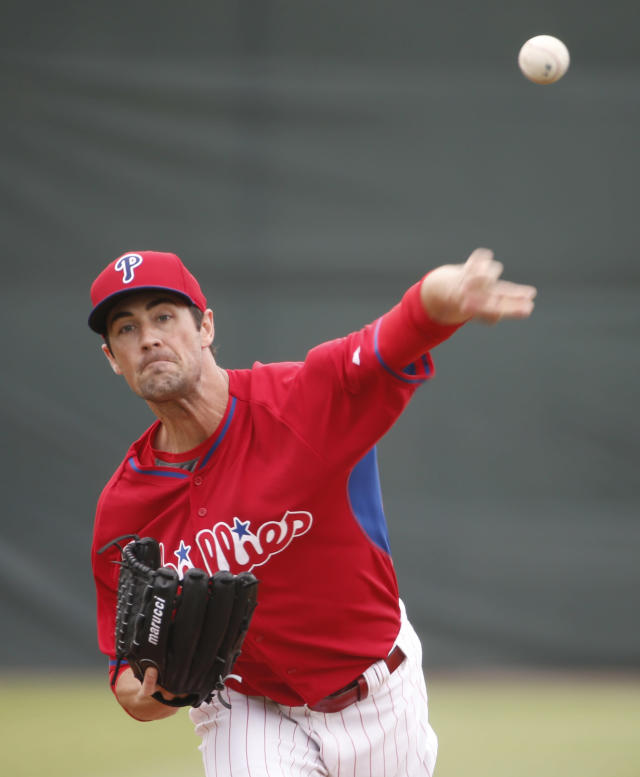 Philadelphia Phillies starting pitcher Cole Hamels delivers in the first inning of a spring exhibition baseball game against the Pittsburgh Pirates Triple-A team in Clearwater, Fla., Thursday, March 27, 2014. (AP Photo/Kathy Willens)