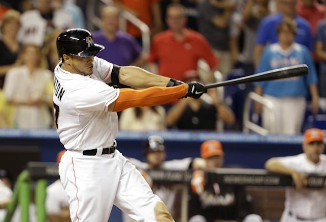 Miami Marlins' Giancarlo Stanton hits a grand slam to defeat the Seattle Mariners 8-4 during the ninth inning of an interleague baseball game on Friday, April 18, 2014, in Miami. (AP Photo/Lynne Sladky)