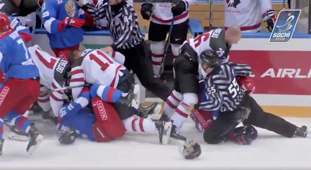 Players from Canada and Russia throw down at the Sochi Hockey Open.