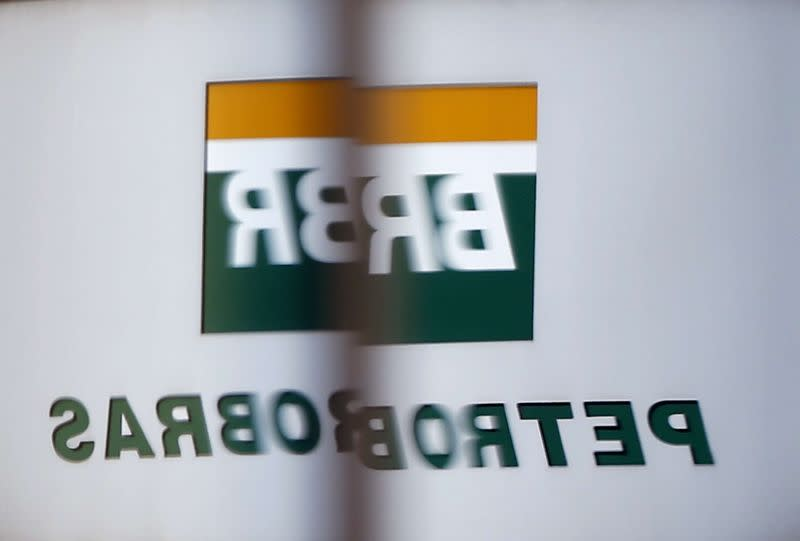 The Petrobras logo is reflected in the window of the company's headquarters in Sao Paulo