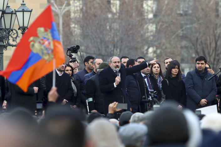 Armenian Prime Minister Nikol Pashinyan gestures speaking to a crowd in the center of Yerevan, Armenia, Thursday, Feb. 25, 2021. Armenia's prime minister has spoken of an attempted military coup after facing the military's General Staff demand to step down. The developments come after months of protests sparked by the nation's defeat in the Nagorno-Karabakh conflict with Azerbaijan. (Hayk Baghdasaryan/PHOTOLURE via AP)
