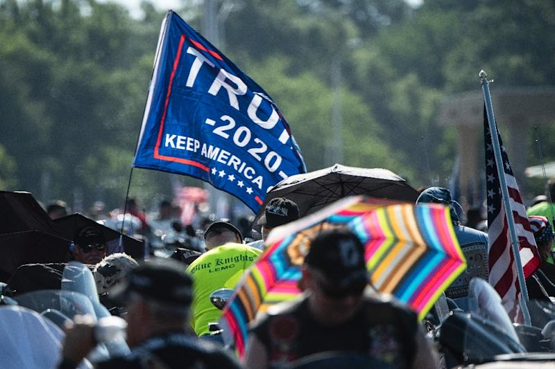 """A """"Trump 2020"""" flag is seen as thousands of bikers gather on a Pentagon parking lot before taking part in the """"Rolling Thunder"""" parade on May 26, 2019 (AFP Photo/Eric BARADAT)"""