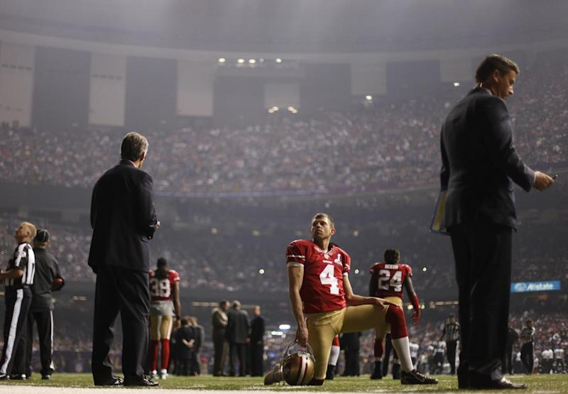 San Francisco 49ers punter Andy Lee (4) looks on during a power outage in the second half of the NFL Super Bowl XLVII football game against the Baltimore Ravens, Sunday, Feb. 3, 2013, in New Orleans. (AP Photo/David Goldman)