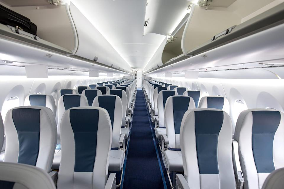 """Choosing an aisle seat """"allows you to get up and walk up and down the aisle from time to time to avoid stiffness, poor posture, and leg cramps, and gets the blood circulating better,"""" advises Lindsay Orosz, a physician's assistant at the Virginia Spine institute."""