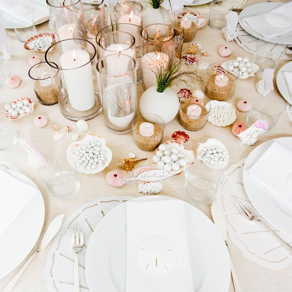 "<p>If a beach vacation isn't on your calendar, the next best thing is a sea-themed dinner party. Darcy Miller suggests bringing the ocean indoors with shells. ""Use shells for decor, place-card holders, and even favors,"" says Miller. Along with decorating your table with real shells, consider scallop shells for holding candy and place cards made of paper print outs of shells and sea creatures. ""And if the party's at night, set votives in larger glass containers filled with sand to bump up the beachy vibe,"" says Miller. </p><p>via <a href=""http://www.darcymillerdesigns.com/"" target=""_blank"">Darcy Miller</a></p>"