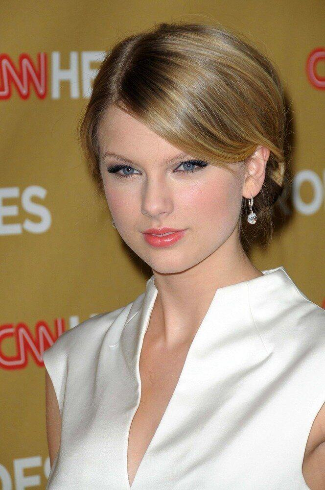 """Taylor's self-titled 2006 album contains a song called """"Tim McGraw"""" professing her love for the country star. Although Taylor's gone in a more pop direction with her recent albums, she still stays true to her country roots -- and she's made <a href=""""http://www.billboard.com/column/the-615/taylor-swift-makes-country-songs-history-1008041582.story#/column/the-615/taylor-swift-makes-country-songs-history-1008041582.story"""">country music history</a> with her number-one hits."""