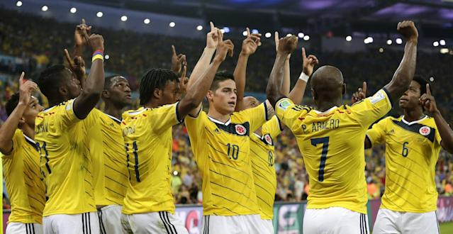 Colombia's James Rodriguez (10) celebrates with his teammates after he scored his side's second goal during the World Cup round of 16 soccer match between Colombia and Uruguay at the Maracana Stadium in Rio de Janeiro, Brazil, Saturday, June 28, 2014. (AP Photo/Marcio Jose Sanchez)