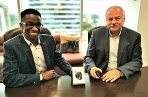 Lenica Research CEO Simba Nyazika (left) and Health Gauge CEO Randy Duguay (right) are set to launch Lenica's new Peak Cognition sports training platform, which will incorporate key health data from Health Gauge's new Phoenix biometric health monitor, shown here.