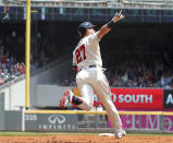 Atlanta Braves' Austin Riley celebrates after hitting his second home run as he rounds second base during the third inning of a baseball game against the Pittsburgh Pirates, Sunday, May 23, 2021, in Atlanta. (Curtis Compton/Atlanta Journal-Constitution via AP)