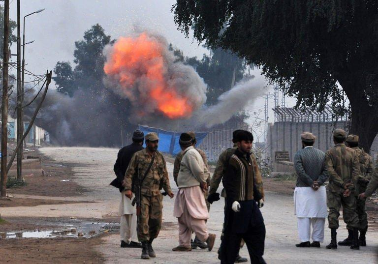 Troops detonate a bomb that did not go off during an assault by militants near Peshawar airport on December 16, 2012