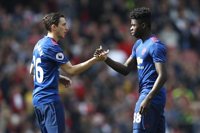 Manchester United's defender Matteo Darmian (L) greets Manchester United's defender Axel Tuanzebe before the English Premier League football match between Arsenal and Manchester United at the Emirates Stadium in London on May 7, 2017 (AFP Photo/Adrian DENNIS)