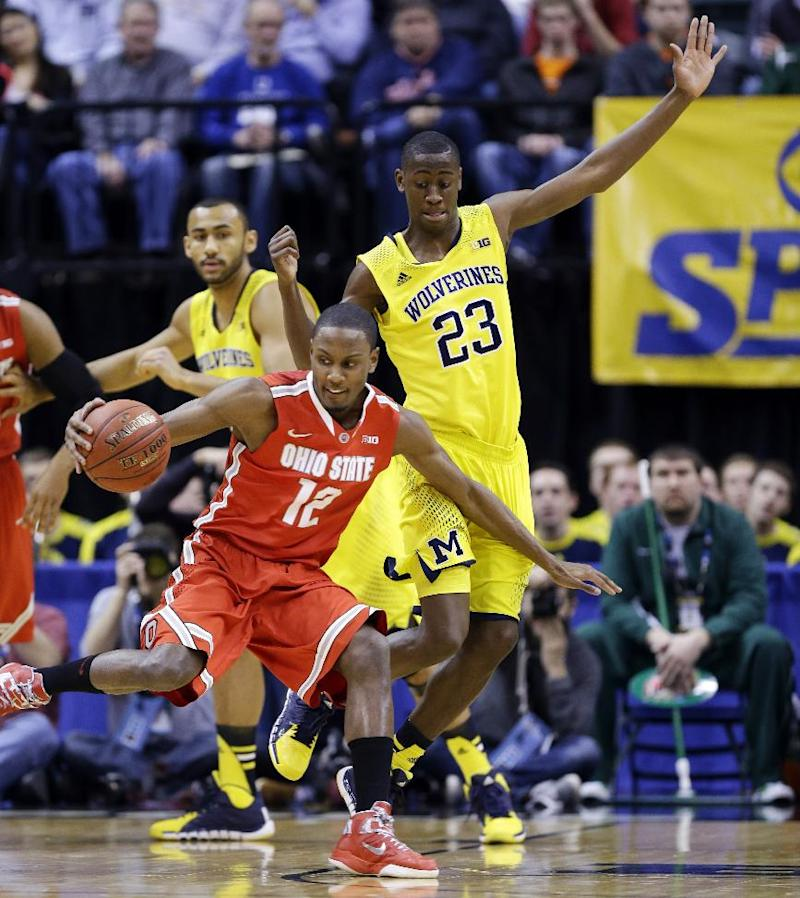 Ohio State forward Sam Thompson (12) drives against Michigan guard Caris LeVert (23) in the first half of an NCAA college basketball game in the semifinals of the Big Ten Conference tournament Saturday, March 15, 2014, in Indianapolis. (AP Photo/Michael Conroy)