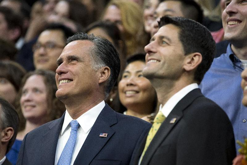 Republican presidential candidate, former Massachusetts Gov. Mitt Romney, left, and his vice presidential running mate Rep. Paul Ryan, R-Wis., pose for photos with campaign staff before a walk through on the stage of the Republican National Convention on Thursday, Aug. 30, 2012, in Tampa, Fla. (AP Photo/Evan Vucci)