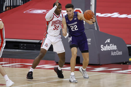 Northwestern's Pete Nance, right, posts up against Ohio State's E.J. Liddell during the second half of an NCAA college basketball game Wednesday, Jan. 13, 2021, in Columbus, Ohio. (AP Photo/Jay LaPrete)