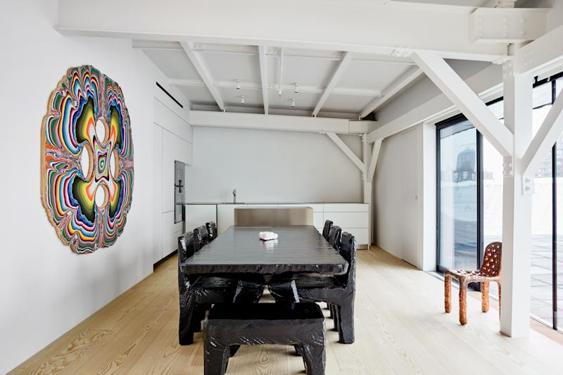 A Max Lamb dining suite and a painting by Holton Rower; kitchen by Bulthaup with Gaggenau appliances.