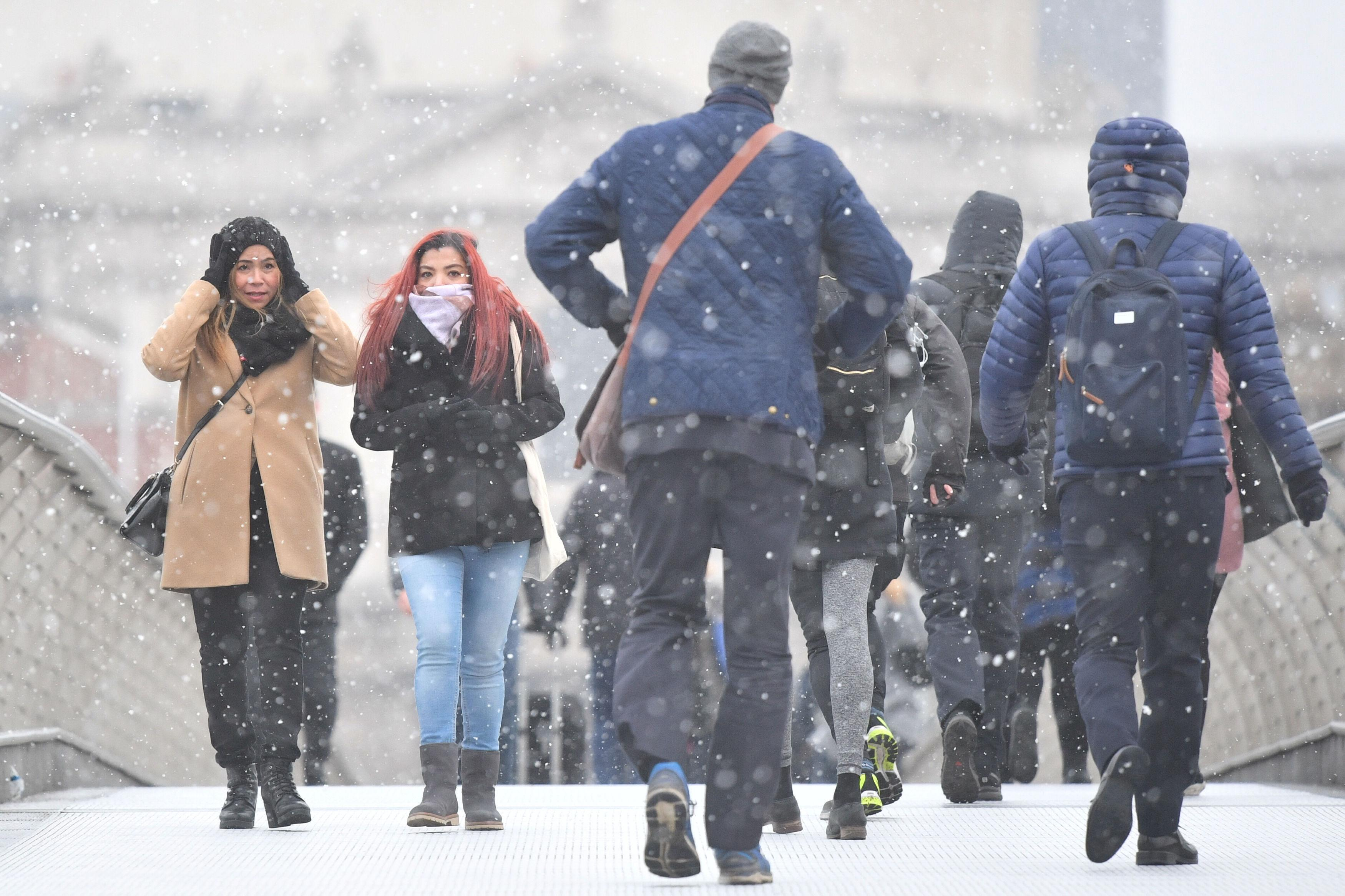 Commuters get caught up in the snow on the Millennium Bridge in London on Monday morning (Picture: PA)