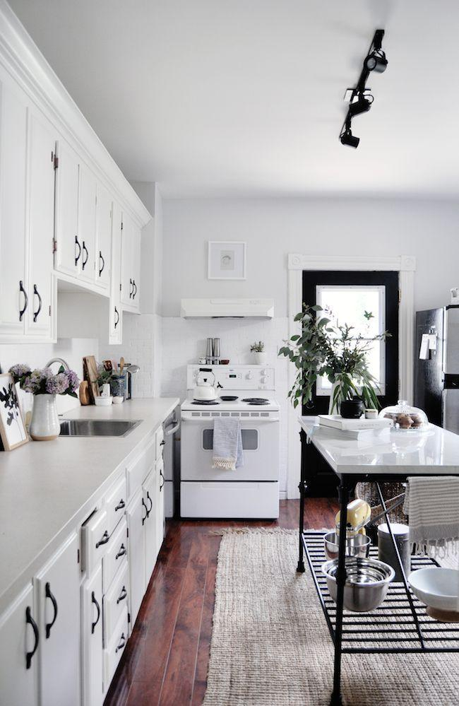 "<p>While this kitchen by <a href=""http://www.jacquelynclark.com/2017/07/13/easy-kitchen-update/"" rel=""nofollow noopener"" target=""_blank"" data-ylk=""slk:Lark & Linen"" class=""link rapid-noclick-resp"">Lark & Linen</a> didn't undergo any huge renovations, it looks decidedly better. With a makeshift kitchen island that provides extra work space and storage, fresh white paint, and more task lighting instead of a retro ceiling fan, it's good to go. </p>"