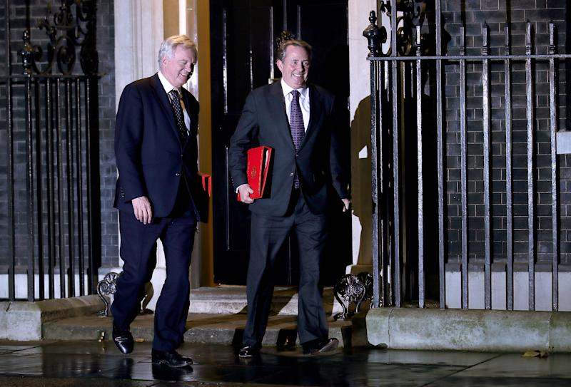 Brexit Secretary David Davis and Liam Fox leave the meeting. (Christopher Furlong via Getty Images)