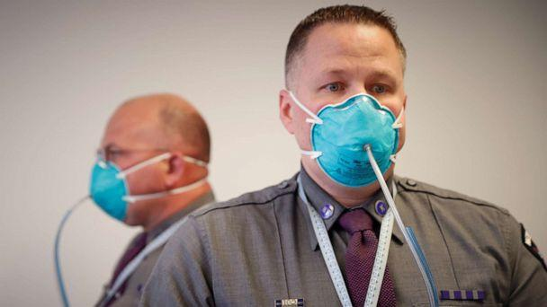 PHOTO: New York State Police Troopers are fitted for N95 protective masks at a New York State emergency operations incident command center during the coronavirus outbreak in New Rochelle, N.Y., March 17, 2020. (Mike Segar/Reuters)