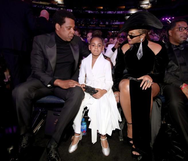 Jay-Z, left, Blue Ivy and Beyoncé attend the 60th Grammy Awards.