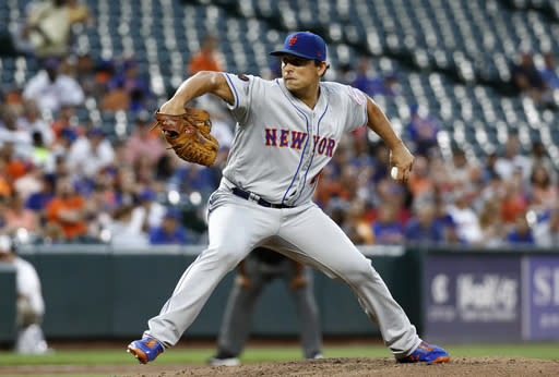 New York Mets starting pitcher Jason Vargas throws to the Baltimore Orioles in the third inning of a baseball game, Tuesday, Aug. 14, 2018, in Baltimore. (AP Photo/Patrick Semansky)