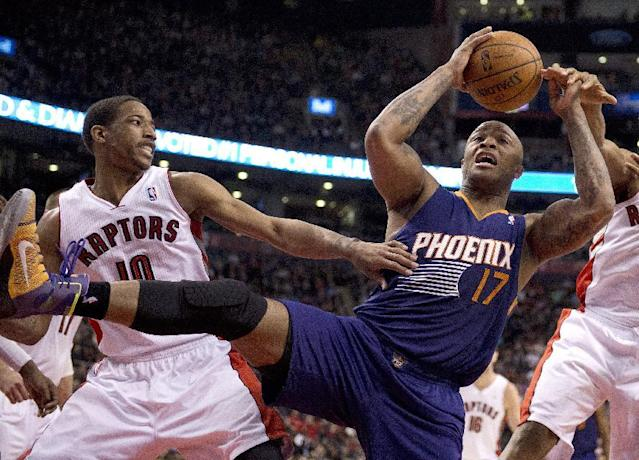 Toronto Raptors guard DeMar DeRozan (10) and Phoenix Suns guard P.J.Tucker (17) battle for a rebound during the first half of an NBA basketball game in Toronto on Sunday, March 16, 2014. (AP Photo/The Canadian Press, Frank Gunn)