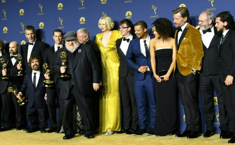"""""""Game of Thrones"""" author George RR Martin and the cast of the HBO show pose with the best drama series Emmy -- the ninth for the program this year"""