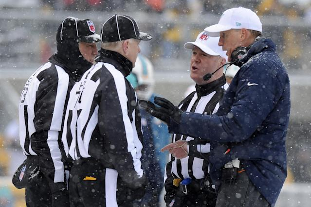 Miami Dolphins head coach Joe Philbin, right, talks with officials during the first half of an NFL football game against the Pittsburgh Steelers in Pittsburgh, Sunday, Dec. 8, 2013. (AP Photo/Don Wright)