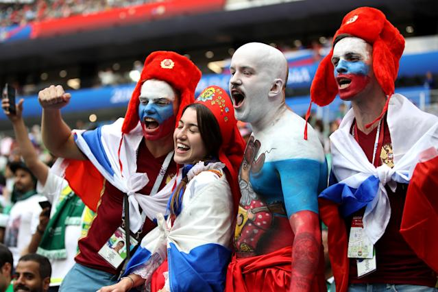 <p>Russian fans don body paint to show their colours in the stands at the Luzhniki Stadium. (PA) </p>