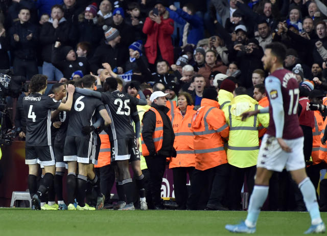 Leicester's Jamie Vardy celebrates with teammates after scoring his side's fourth goal during the English Premier League soccer match between Aston Villa and Leicester City at Villa Park in Birmingham, England, Sunday, Dec. 8, 2019. (AP Photo/Rui Vieira)