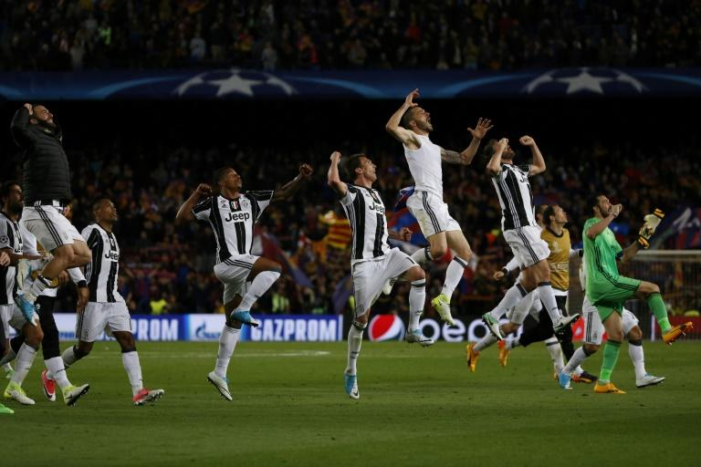 Juventus players celebrate winning after their UEFA Champions League quarter-final second leg match against Barcelona at the Camp Nou stadium in Barcelona on April 19, 2017